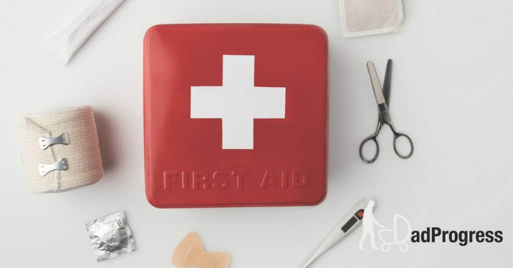 Red First Aid Kit With A White Cross On It And Different Items Around It