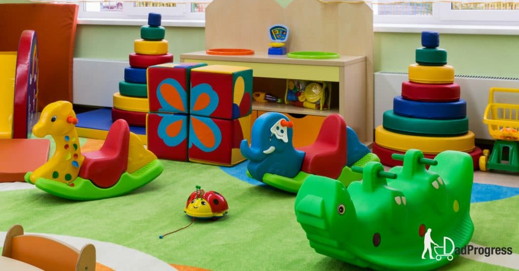A nursery with many toys (including many colourful ride on toys)