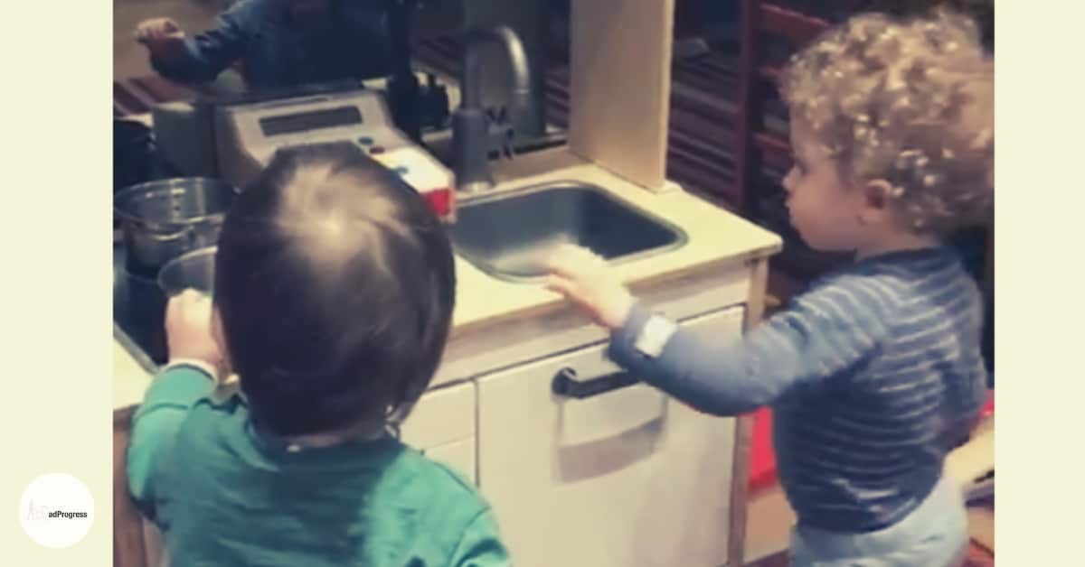 Two Toddler Playing With a Play Kitchen