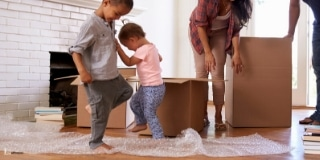 Two Toddlers Stomping on a Bubble Wrap