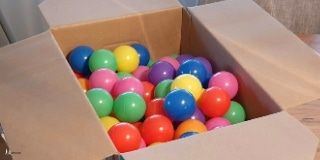 Plastic balls in a carboard box