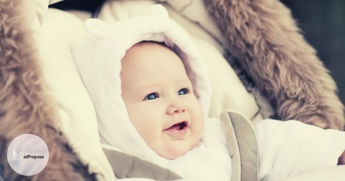 Smiling Baby in a Footmuff- Best Footmuff Featured Image