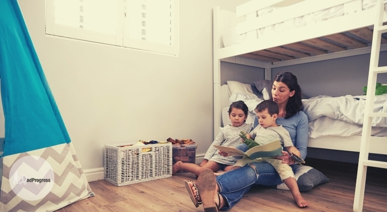 Mother reading to children and a bunk bed