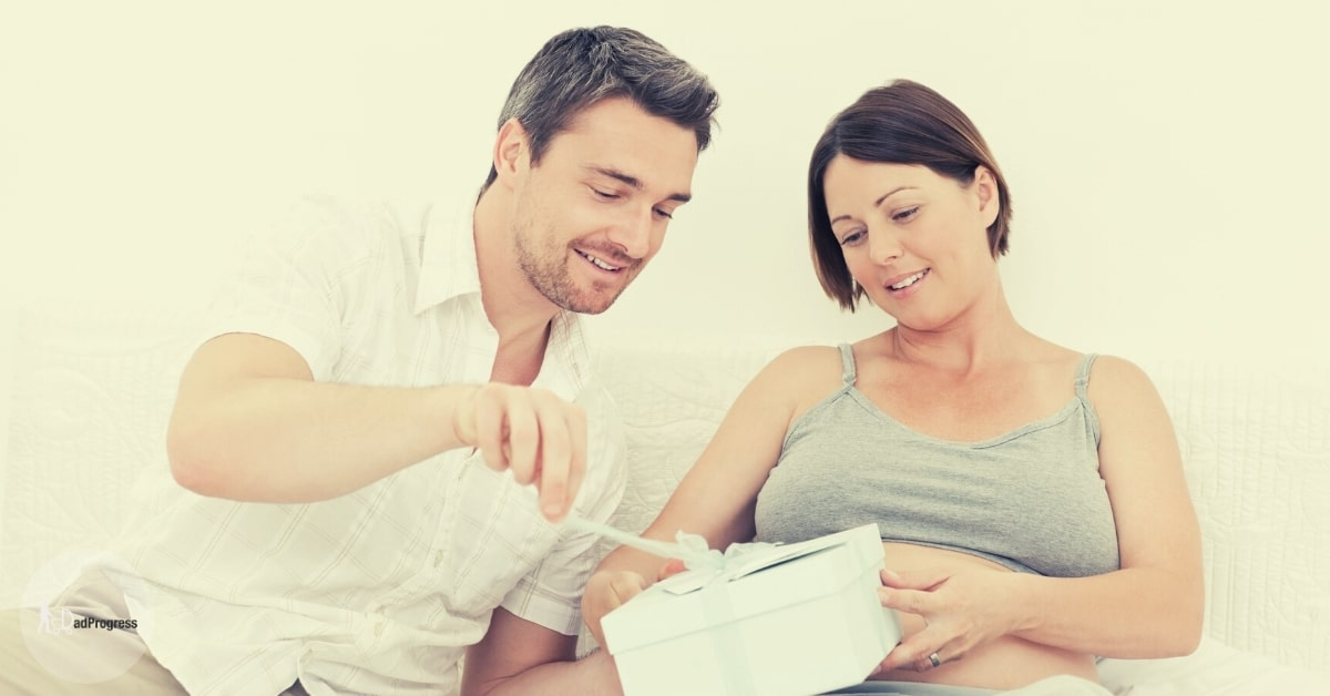 Man and a Woman Opening a Present (Push present for dads) Together in a Bed