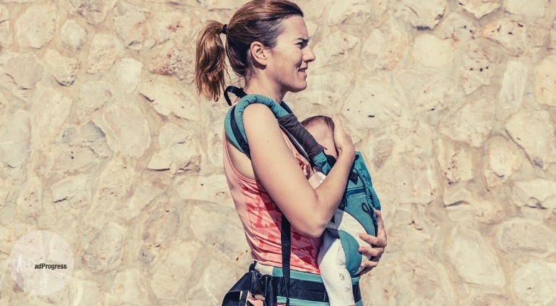 Woman carrier a baby in a baby carrier