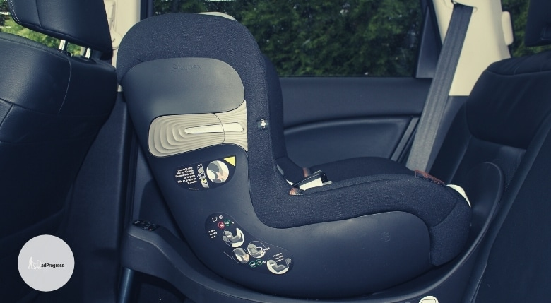 Black car seat in a car to illustrate the chicco vs graco debate