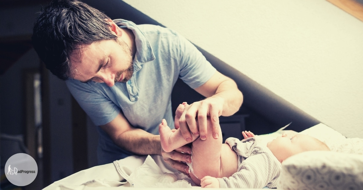 Dad Changes a dipaer on a How To Change A Diaper Featured Image