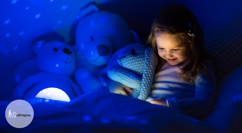 Older child and a nightlight in a bed