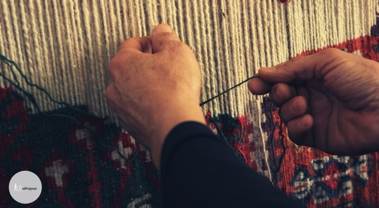 Somebody makes a hand-knotted carpet