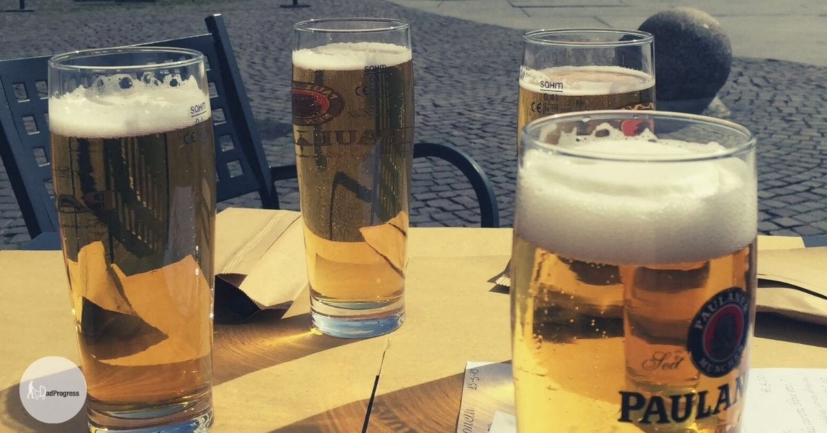 Fours glasses with Paulaner beer outside on a table
