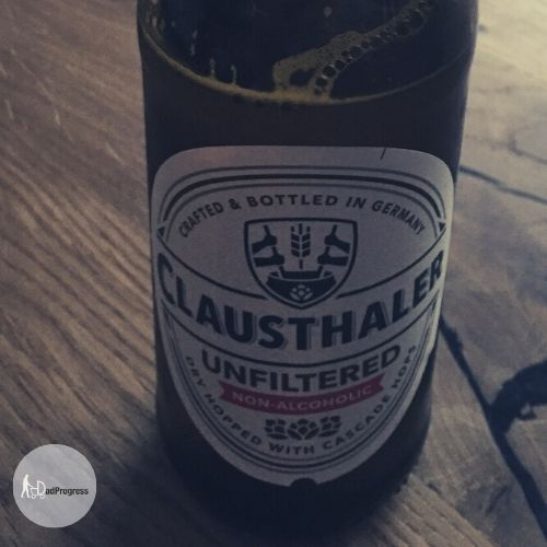 Claustharer Unfiltered Non-Alcoholic Lager on a table
