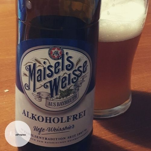 Maisel's Weisse Alkoholfrei on a table and a glass behind the bottle