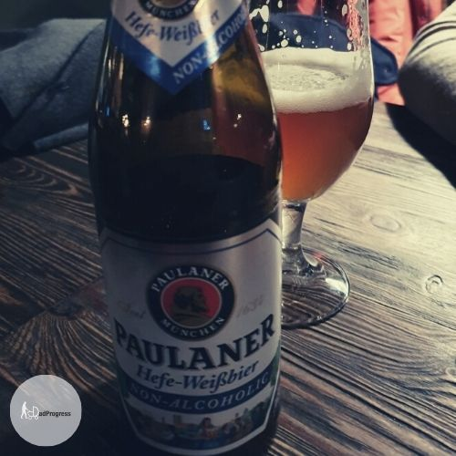 Paulaner Hefe-Weissbier Alkoholfrei on a table and a glass behind the bottle